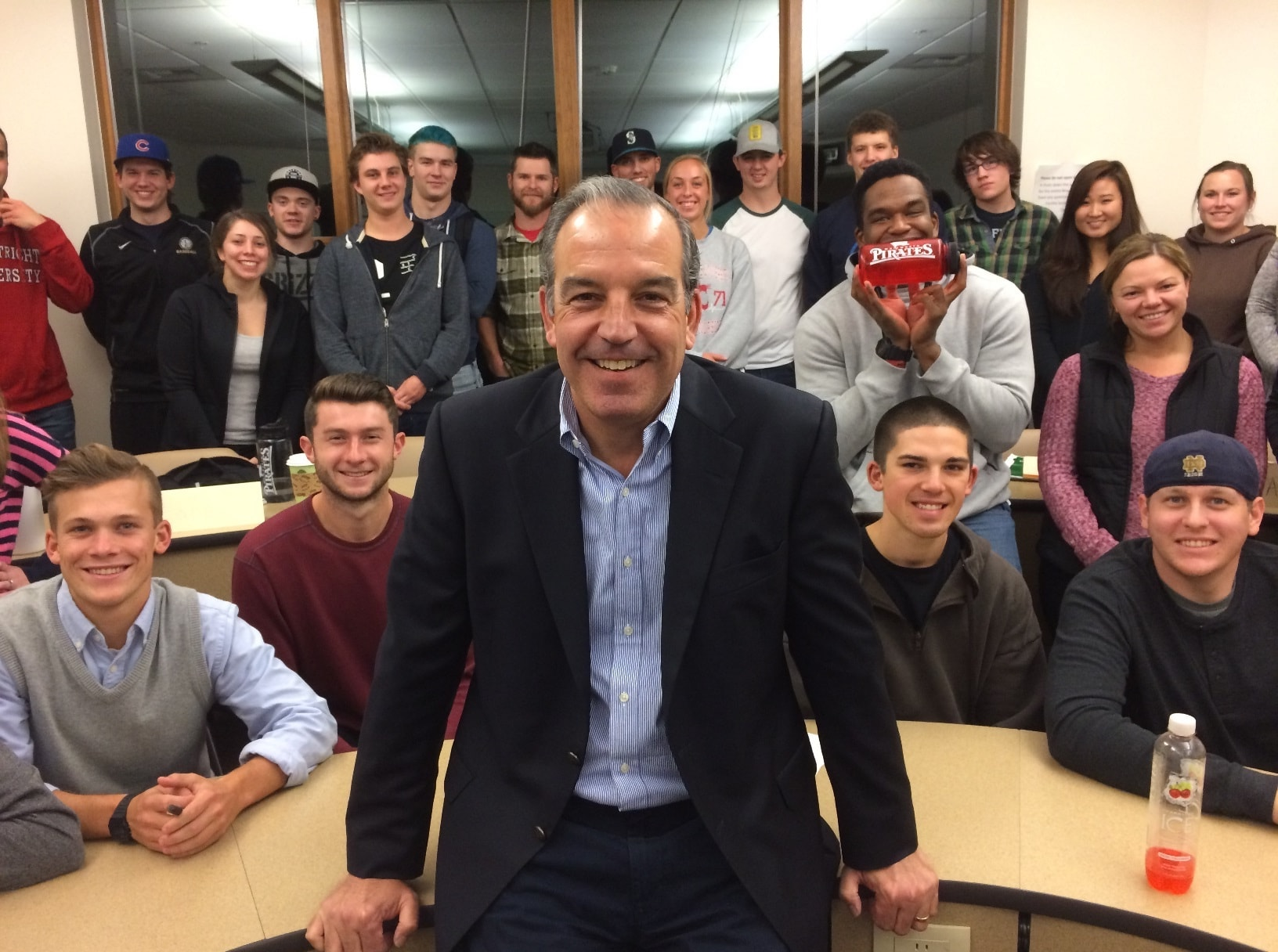 Augie Cruciotti poses with a group of Whitworth business students.